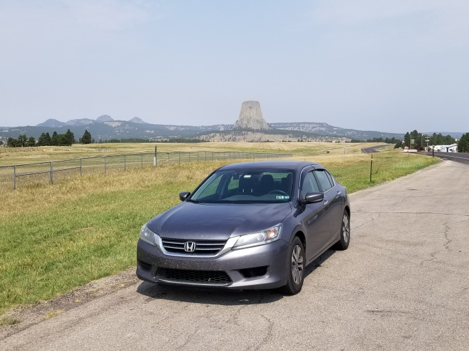 2015 Honda Accord sedan parked in front of Devil's Tower.