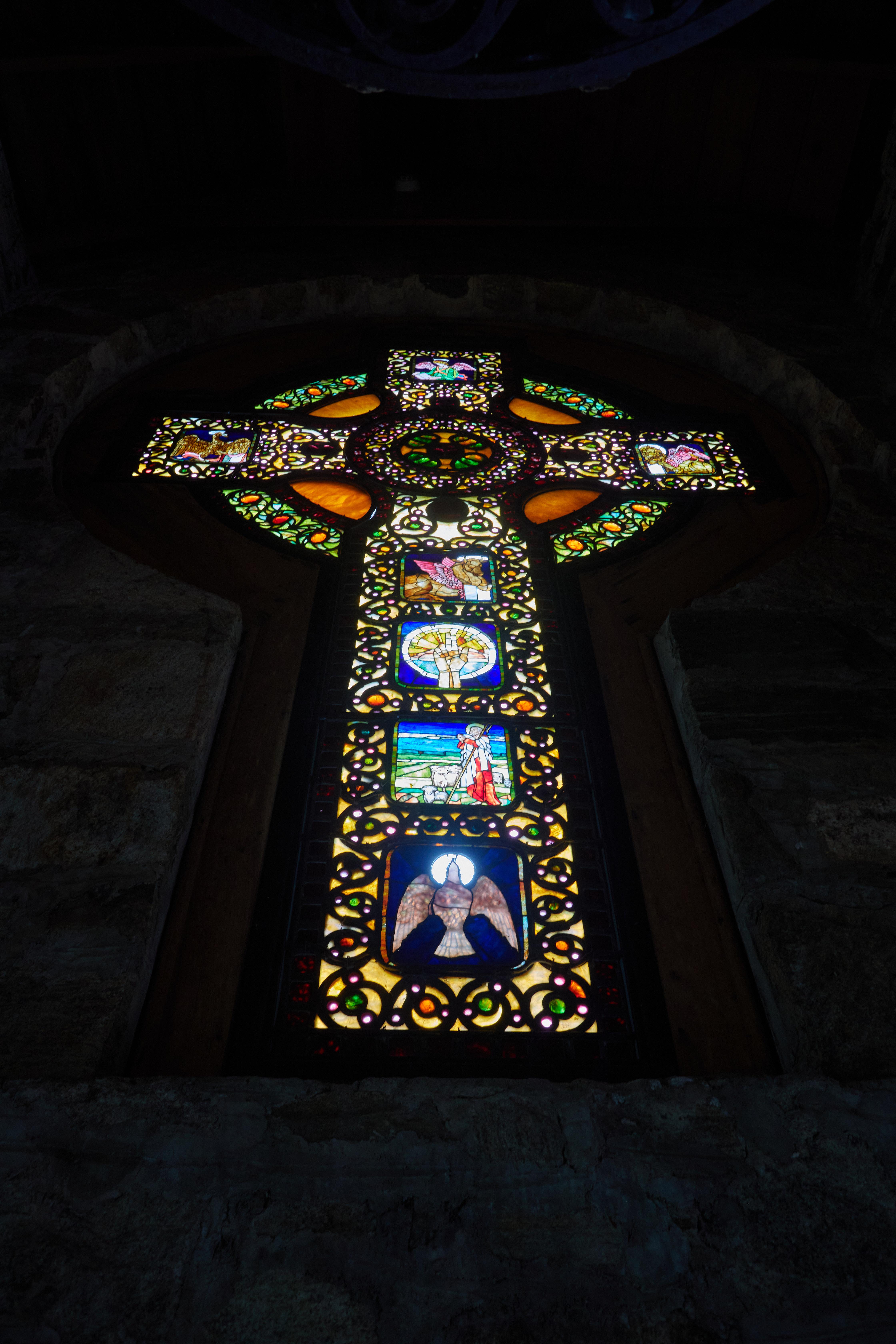 Stained glass window in shape of cross.