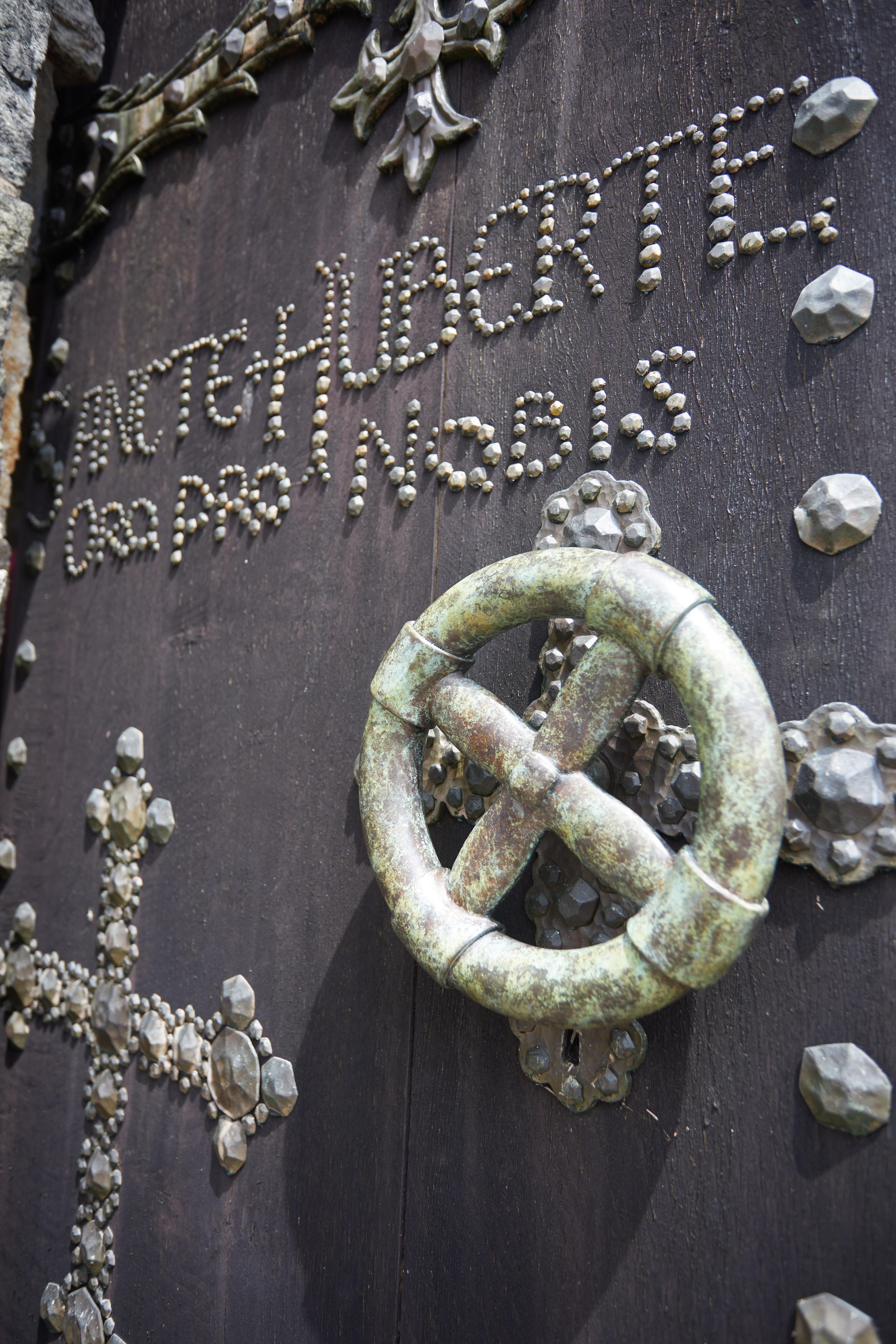 Front door, with words SANCTE HUBERTE ORO PRO NOBIS in stone.