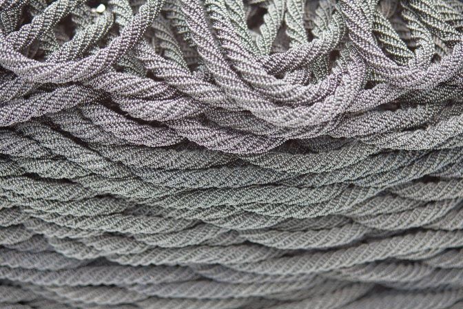 Rope embedded with glass beads.