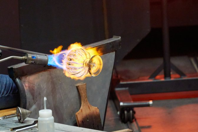 Glass being heated by blowtorch.