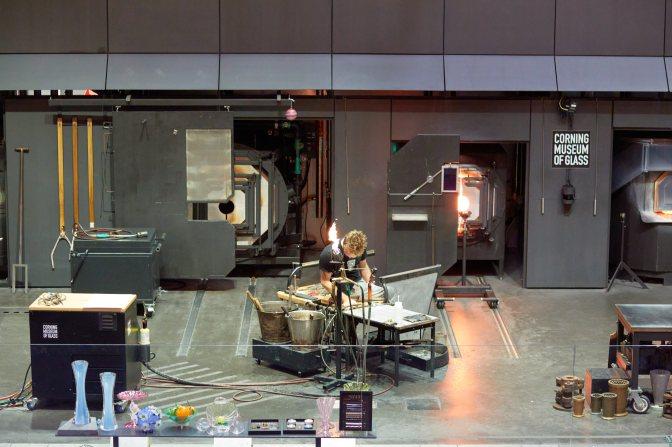 Glass worker in glass studio.