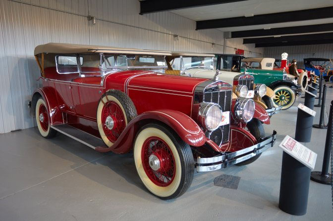 1932 Oldsmobile L32 four-door sedan, in red.