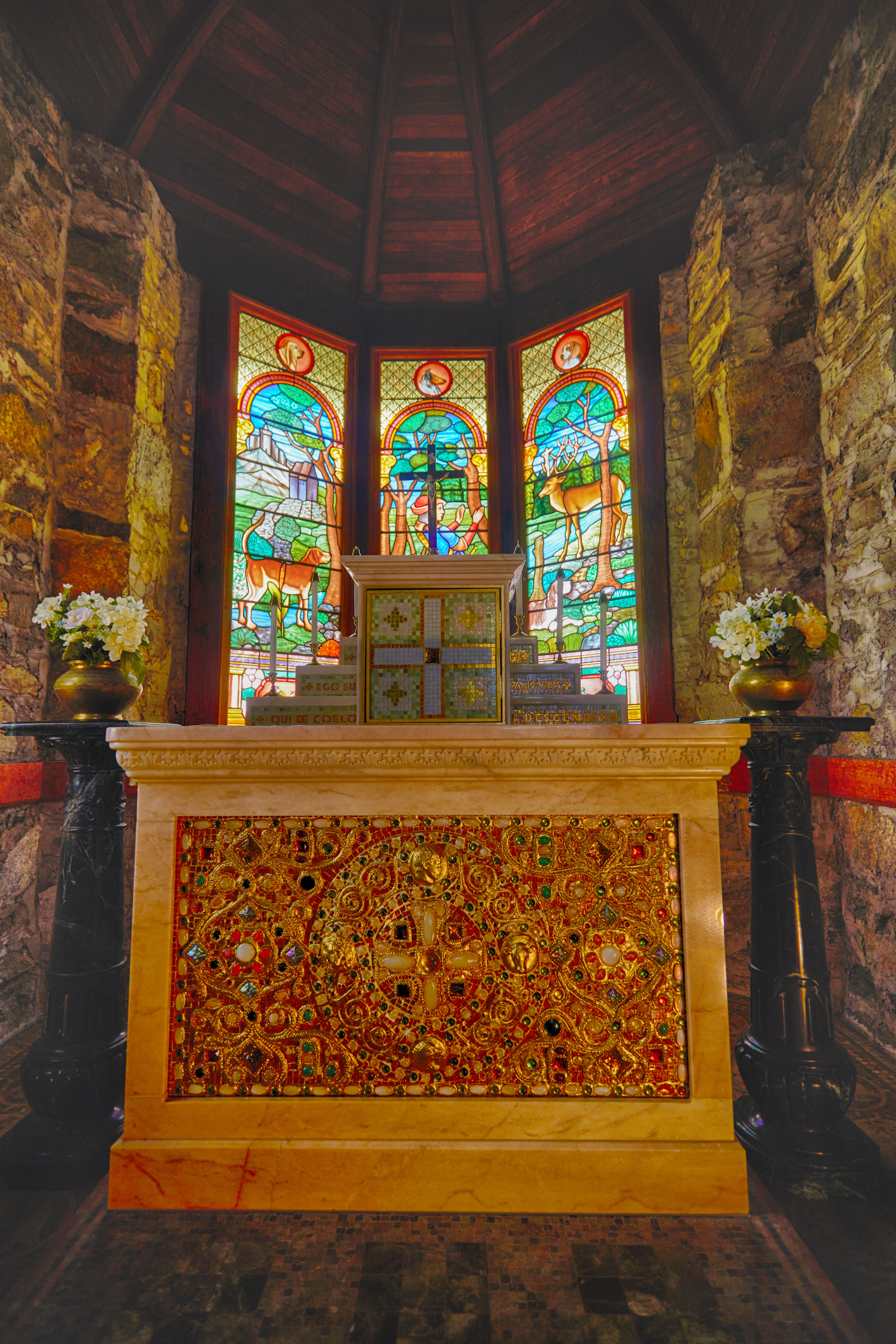 Altar and stained glass windows.