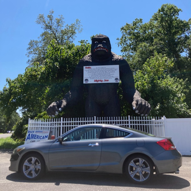 2012 Honda Accord coupe parked in front of gorilla statue.
