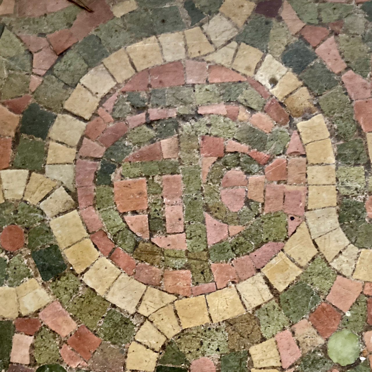 Initials LCT in stone mosaic on floor.