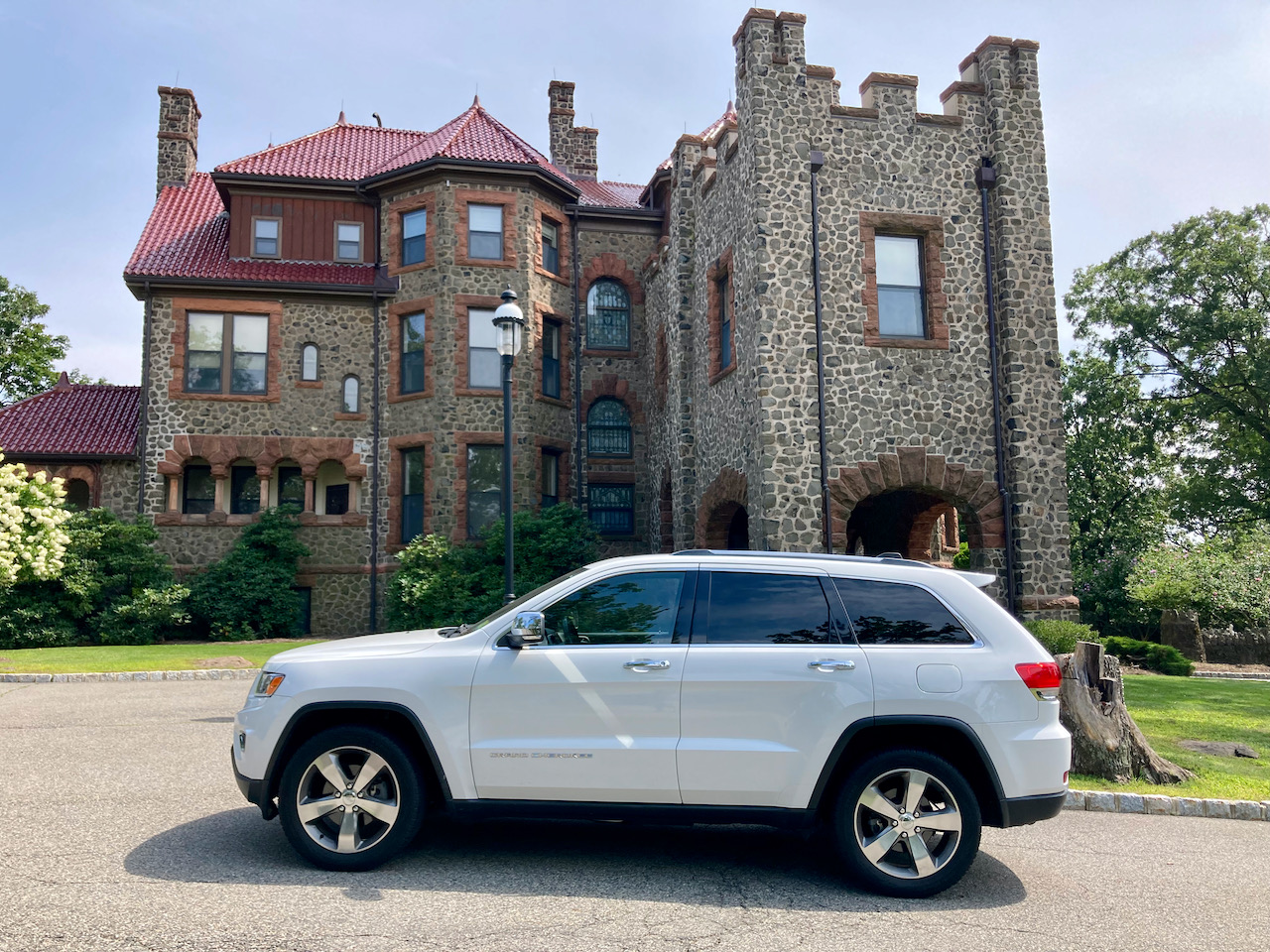 2014 Jeep Grand Cherokee parked in front of Kip's Castle.