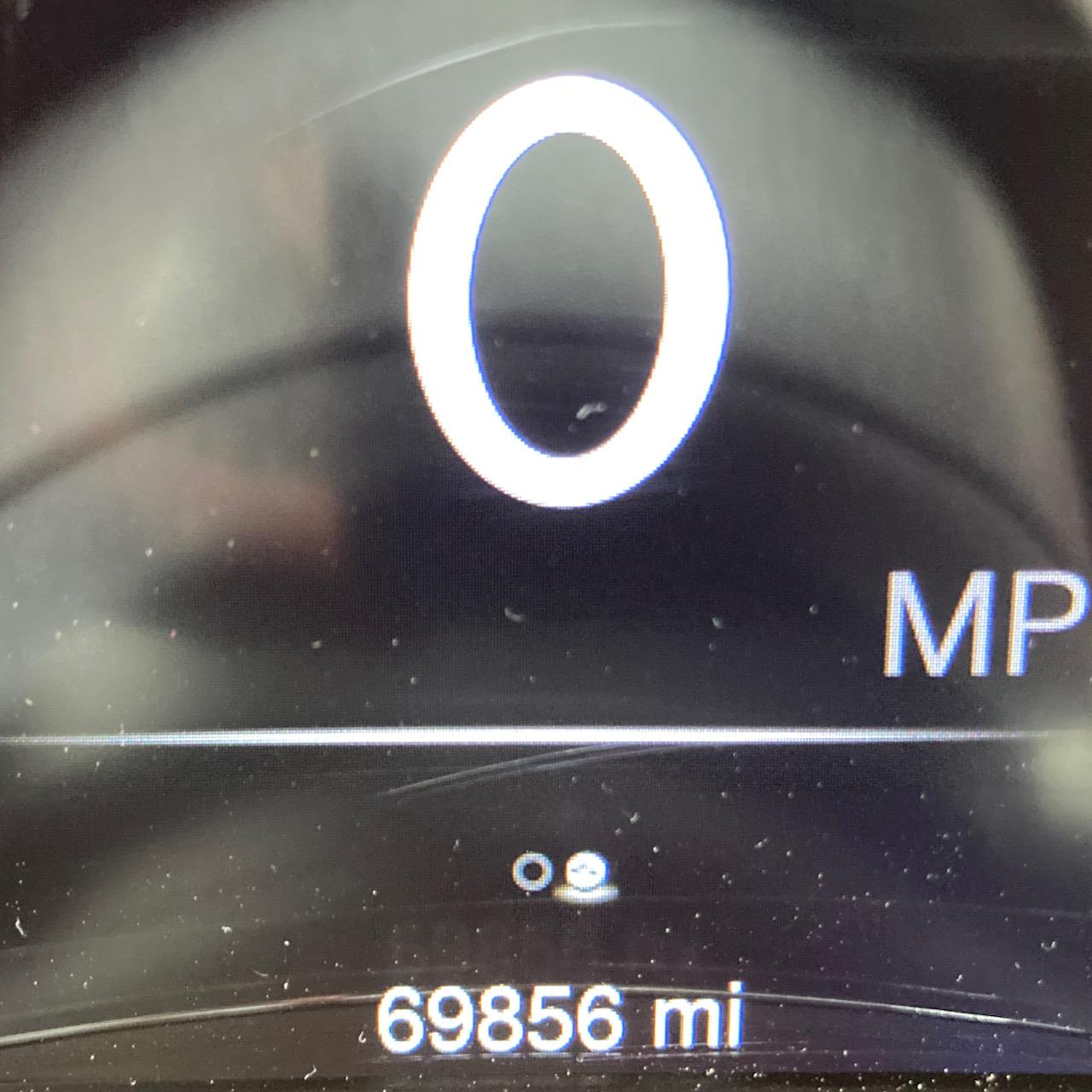 Car odometer reading 69856 miles.
