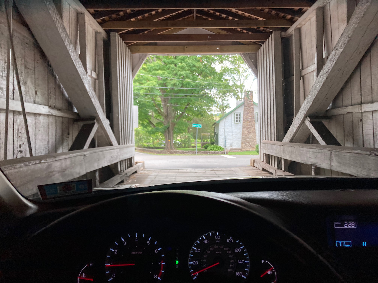 View from inside covered bridge, with dashboard of 2012 Honda Accord in foreground.