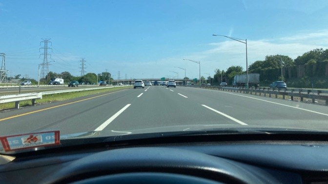 View of NJ Turnpike from behind dashboard of Honda Accord.