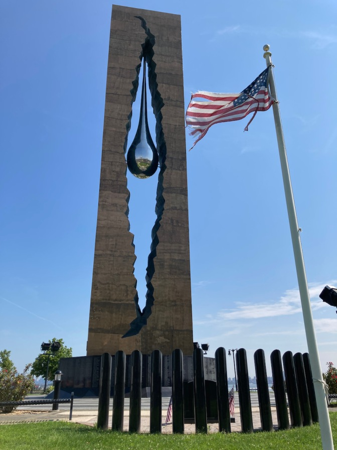 Teardrop Memorial with American flag in foreground.