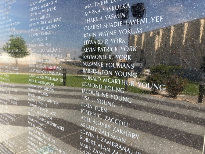 Inscriptions of names of 9/11 victims in granite.
