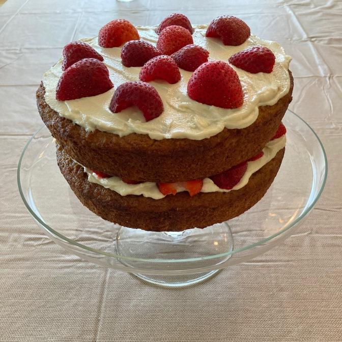 Strawberry shortcake on cake plate.