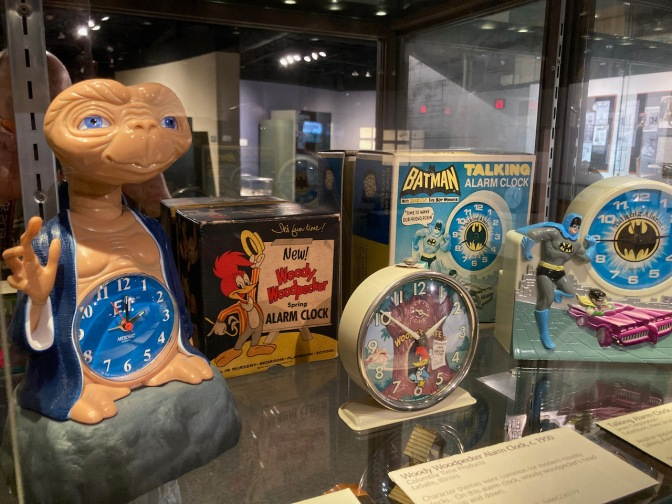 Collection of toy clocks, including ET, Woody Woodpecker, and Batman.