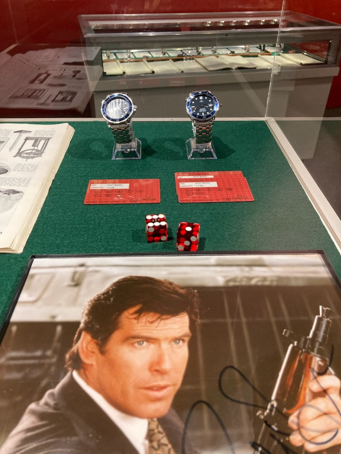 Display with Pierce Brosnan as James Bond, and two Omega watches.