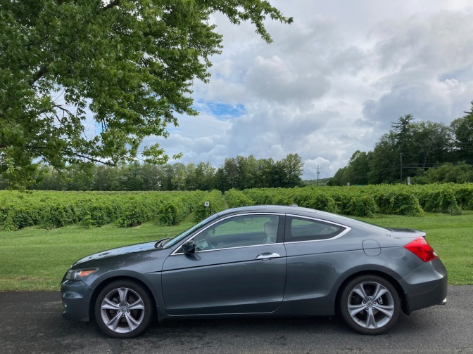 2012 Honda Accord parked in front of vineyard.