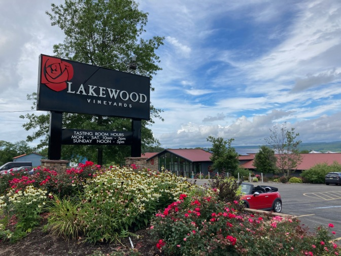Large sign for Lakewood Vineyards and winery is in background.
