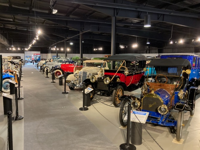 Rows of classic cars in museum.