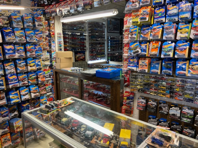 Front counter, with walls filled with die cast toy cars.