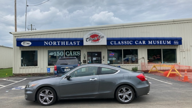 2012 Honda Accord parked in front of entrance to Northeast Classic Car Museum.