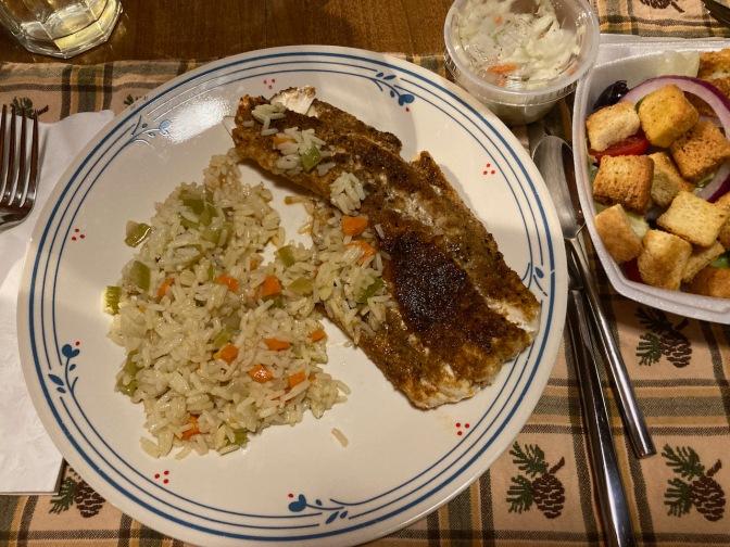 Blackened halibut, rice, and salad.