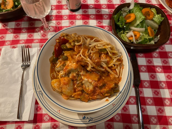 Bowl with shrimp and scallops Fra diavolo with linguini.