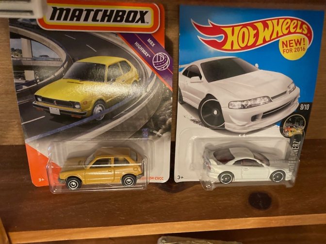 Hot Wheels Acura Integra and Matchbox Honda Civic.