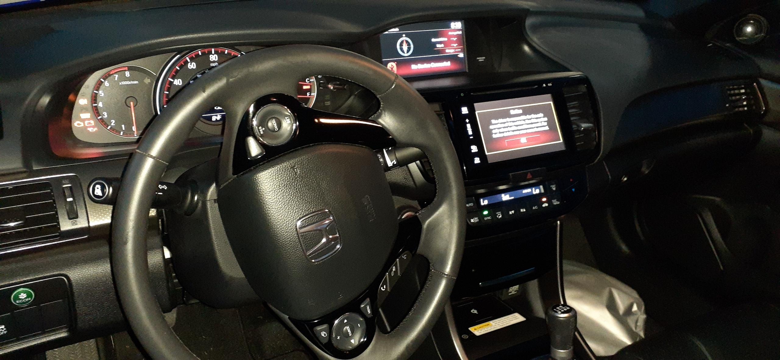 Interior of Honda Accord coupe. Interior trim is black.