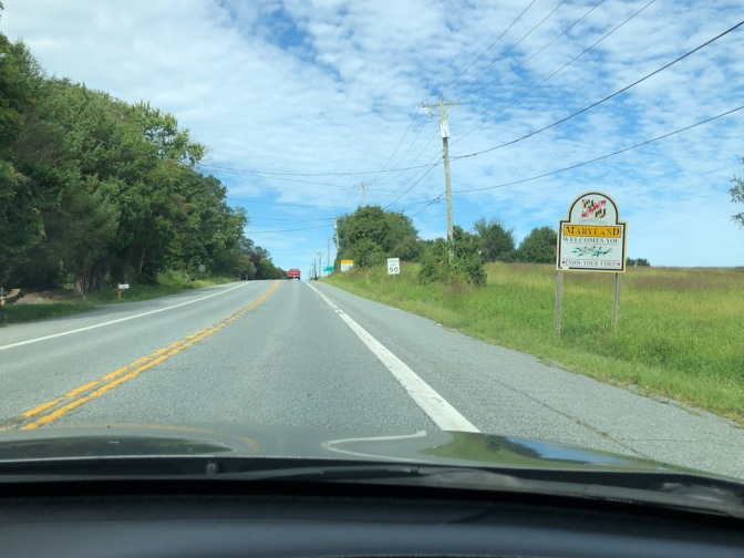 Maryland state welcome sign along side of road.