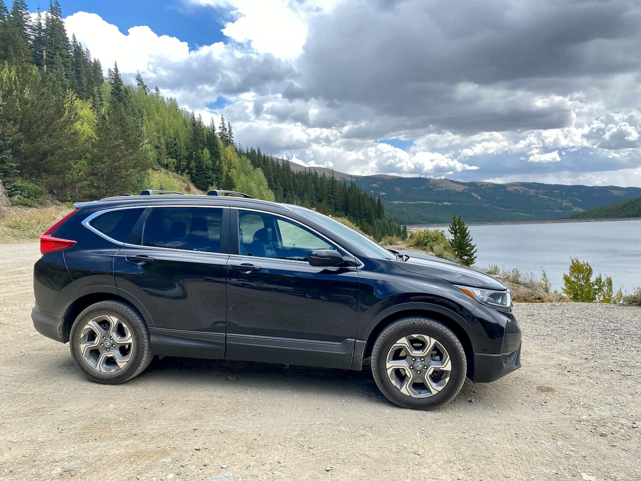 2017 Honda CR-V parked in front of lake and mountains.