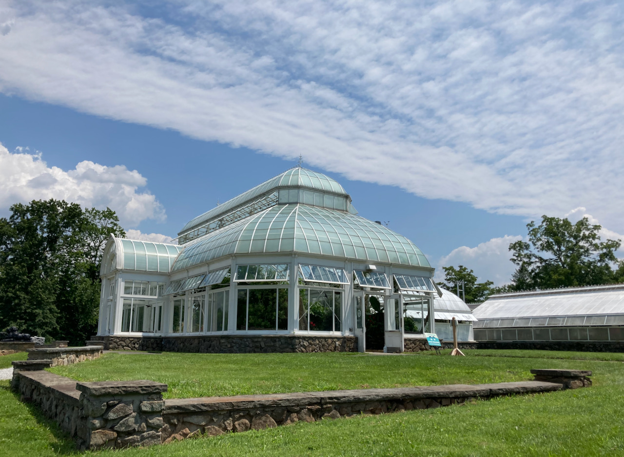 Exterior of The Orchid Range glass hothouse.