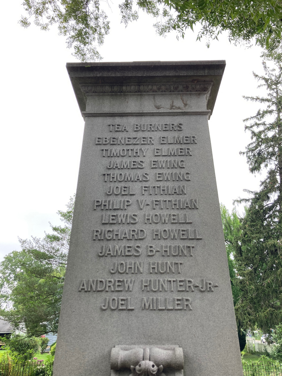 """Monument with names of """"Tea Burners"""" inscribed on side."""