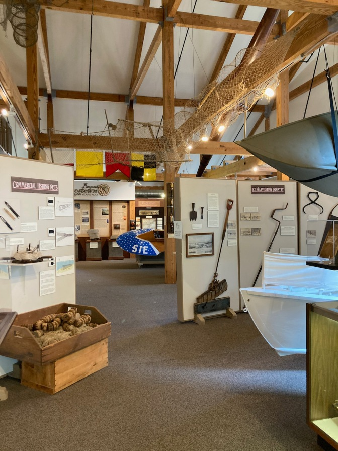 Exhibits on fishing and sailing in museum.