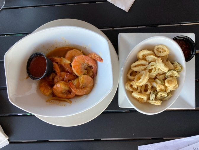 Plate with calamari, and bowl with steamed shrimp.