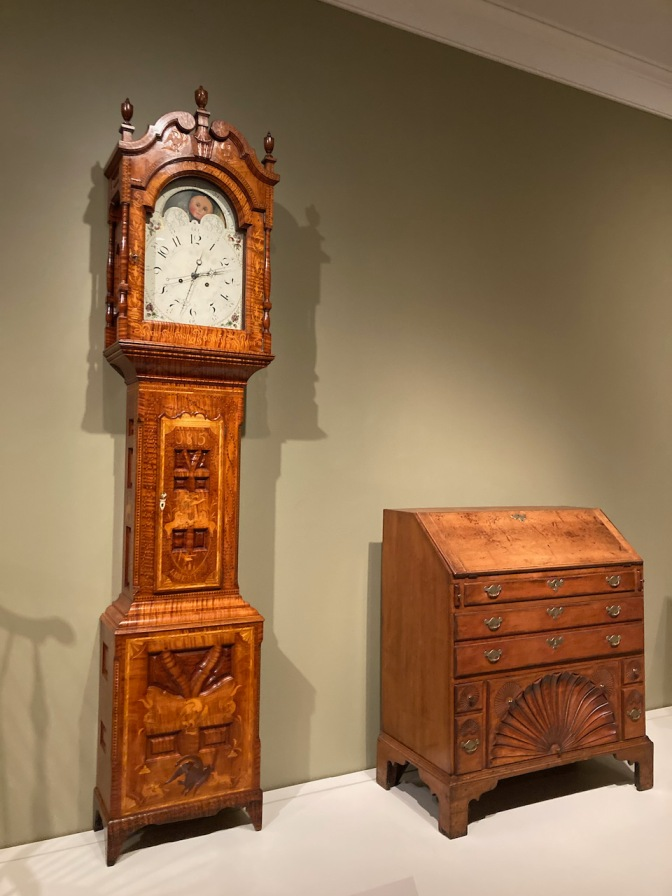 Grandfather clock and chest of drawers.