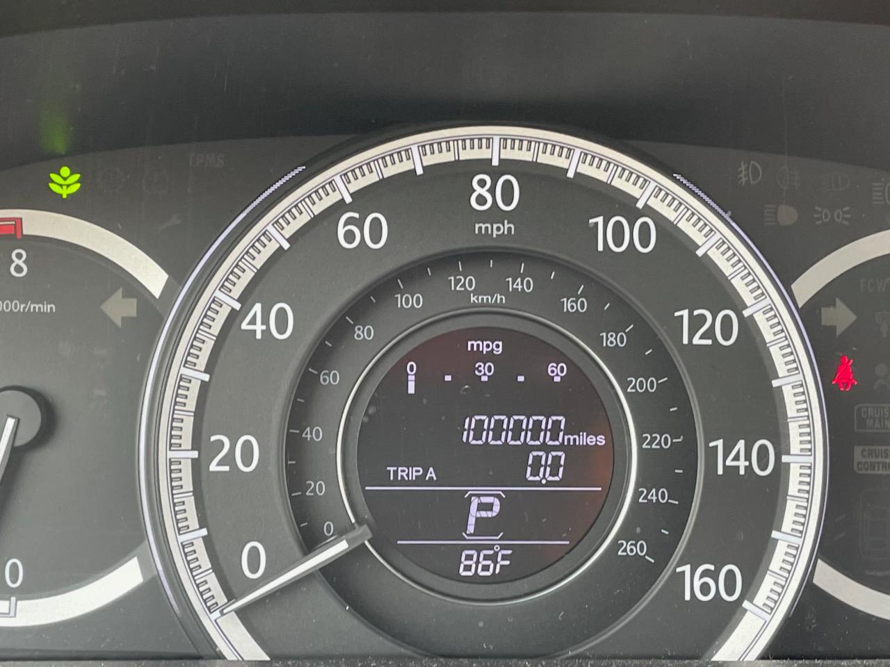 Odometer reading 100,000 miles.
