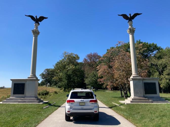 2014 Jeep Grand Cherokee parked between Pennsylvania Columns.