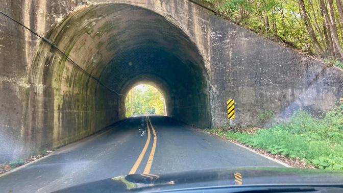 Narrow tunnel beneath hillside.