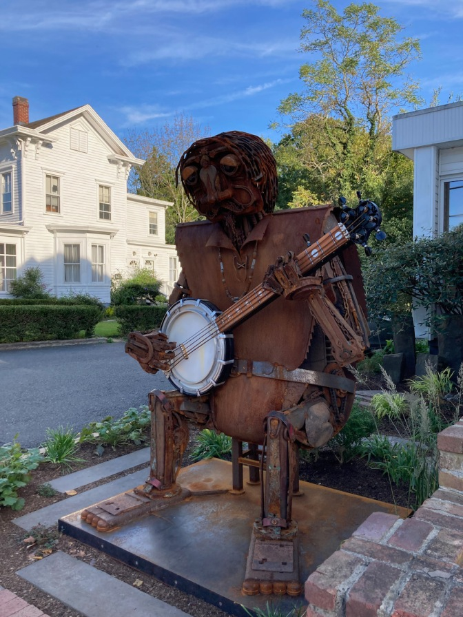 Metal sculpture of banjo player.