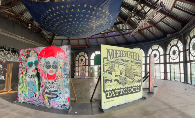 Panorama of carousel house, with art installations.