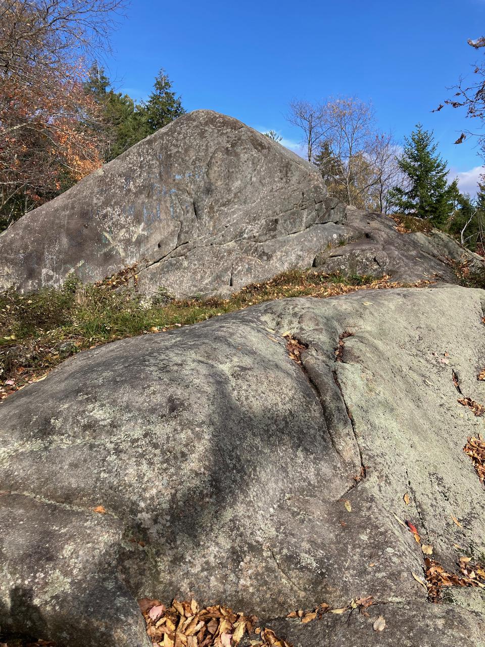 Bare rockface near top of hill.
