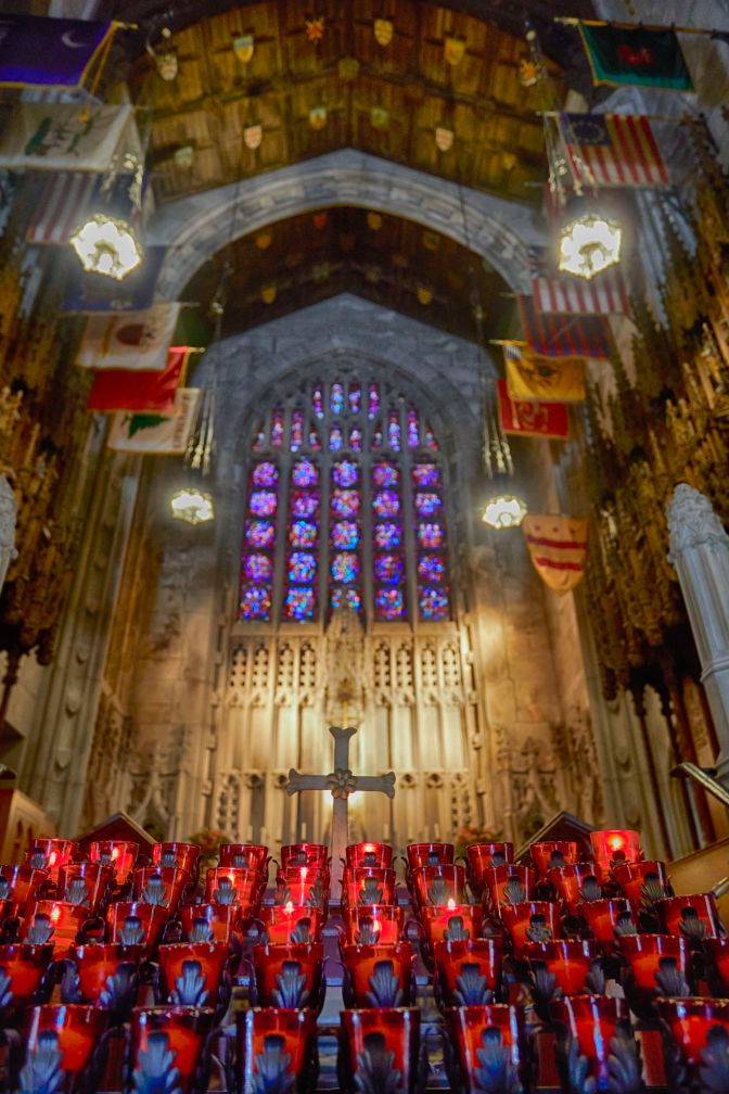 Altar and stained glass window inside of Washington Memorial Chapel.